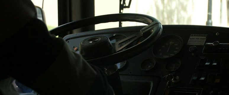 bus-steering-wheel-tight-shot_nnhwsnldg__F0000