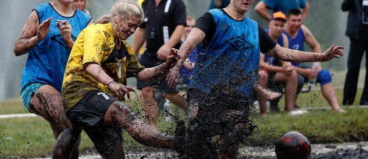 Women compete for the ball in the mud during a swamp soccer game near the village of Dombrovka, Belarus, August 10, 2019., Image: 464073497, License: Rights-managed, Restrictions: , Model Release: no, Credit line: Forum, Reuters