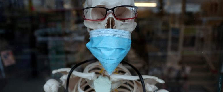 A skeleton mannequin wearing a protective mask is seen in the window of a medical equipment supply store in south London, Britain February 26, 2020. REUTERS/Hannah McKay