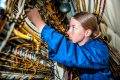 """150609-N-MV308-060 KANEOHE BAY, Hawaii (June 9, 2015) Aviation Electrician's Mate Second Class Morgan Williams, assigned to the """"Golden Eagles"""" of Patrol Squadron (VP) 9, checks the wiring of the main load center on a P-3C Orion maritime patrol aircraft as part of the squadron's advanced readiness program. VP-9 is starting preparations for their inter-deployment readiness cycle, conducting training and maintenance to maximize operational performance readiness and efficiency. (U.S. Navy photo by Mass Communication Specialist 3rd Class Amber Porter/Released)"""