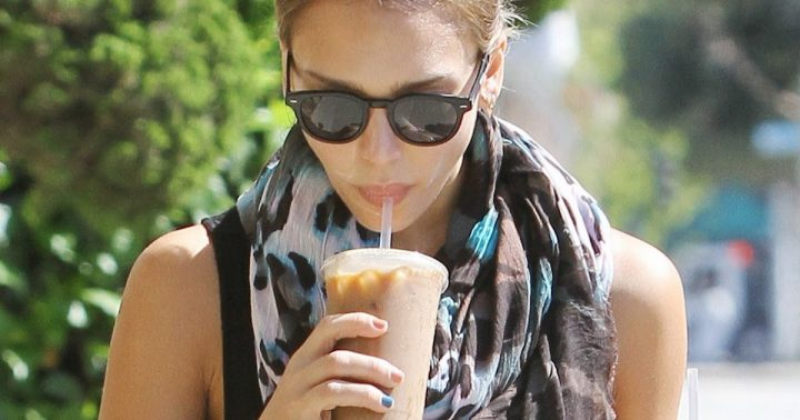 Jessica Alba carries takes two coffees back to her office and looks a little sleepy but all smiles after her caffeine fix. August 28, 2012.  X17online.com EXCLUSIVE