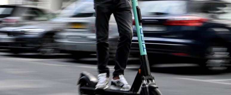 06 August 2019, Berlin: Florian Wagner, plant manager, drives an electric pedal scooter from Tier. Photo by: Britta Pedersen/picture-alliance/dpa/AP Images